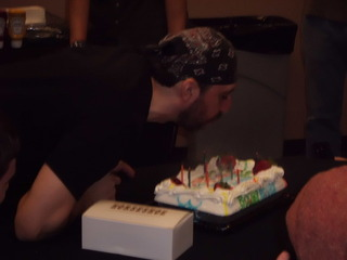Joe blowing out the candles