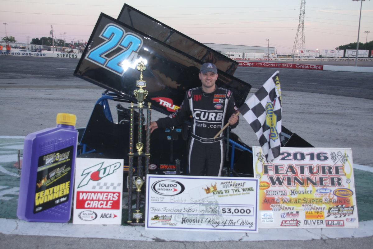 SANTOS FLAT FLIES TO TOLEDO KING OF THE WING WIN
